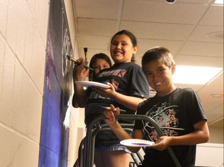 Avery, Memory, and Keandre working on our new mural